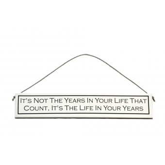 "Decorative wooden sign with message ""It's not the Years in your Life, it's the Life in your Years""."
